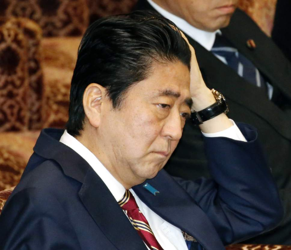 Japanese Prime Minister Shinzo Abe listens to questions during a special committee on the Trans-Pacific Partnership (TPP) at the parliament's upper house in Tokyo Friday, Dec. 9, 2016. Abe won parliamentary approval Friday for ratification of the TPP, despite U.S. President-elect Donald Trump's plan to withdraw from the 12-nation trade pact. Upper house lawmakers approved the TPP, heeding Abe's calls to push ahead with it despite Trump's rejection of the free-trade initiative championed by President Barack Obama. (Yoshinobu Shimizu/Kyodo News via AP)