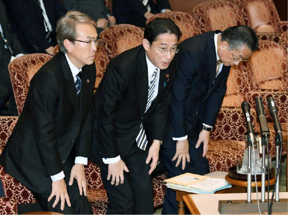 Japanese Economic Revitalization Minister Nobuteru Ishihara, Foreign Minister Fumio Kishida and Agriculture Minister Yuji Yamamoto, from left, bow after the Trans-Pacific Partnership (TPP) was approved during a special committee at the parliament's upper house in Tokyo Friday, Dec. 9, 2016. Prim Minister Shinzo Abe won parliamentary approval Friday for ratification of the TPP, despite U.S. President-elect Donald Trump's plan to withdraw from the 12-nation trade pact. Upper house lawmakers approved the TPP, heeding Abe's calls to push ahead with it despite Trump's rejection of the free-trade initiative championed by President Barack Obama. (Yoshinobu Shimizu/Kyodo News via AP)