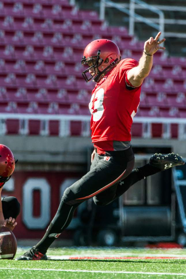 Chris Detrick  |  The Salt Lake Tribune Utes punter Mitch Wishnowsky (33) kicks a field goal during a practice at Rice-Eccles Stadium Tuesday April 5, 2016.