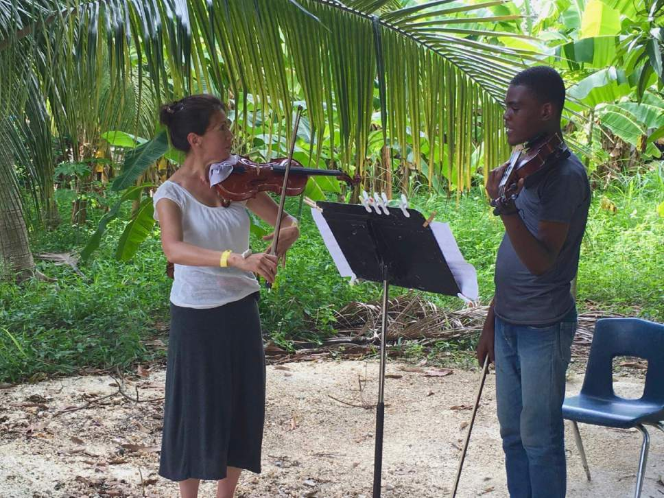 Utah Symphony musicians John Eckstein, Yuki MacQueen and James Hall worked with music students in Haiti this summer and will return in the spring with several of their colleagues and music director Thierry Fischer. Janet Anthony  |  Courtesy