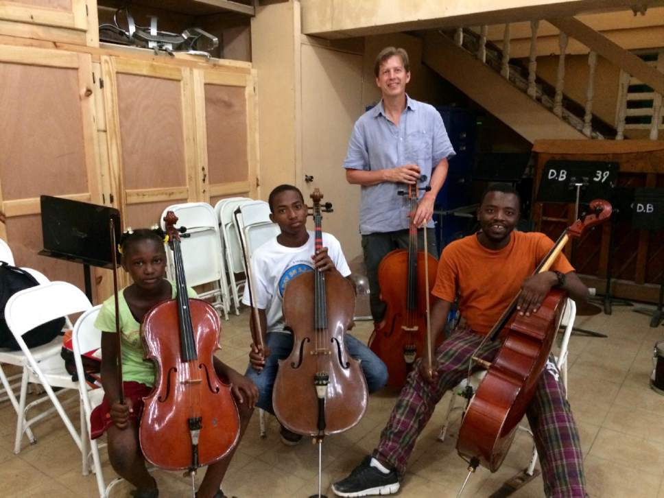 Utah Symphony musicians John Eckstein (tall man in blue shirt), Yuki MacQueen (woman in white top) and James Hall (man in white shirt) worked with music students in Haiti this summer and will return in the spring with several of their colleagues and music director Thierry Fischer. Yuki MacQueen  |  Courtesy