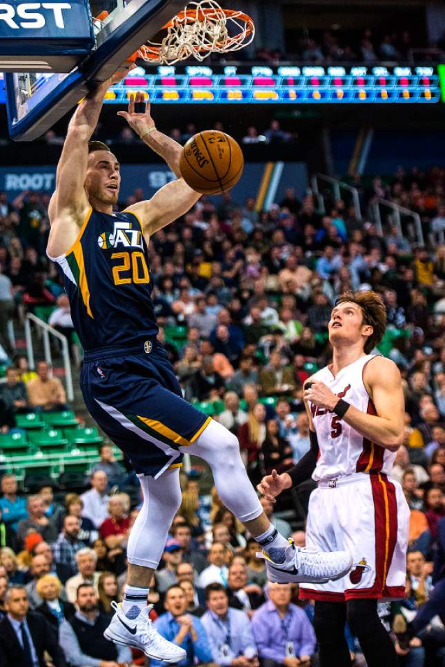 Chris Detrick  |  The Salt Lake Tribune Utah Jazz forward Gordon Hayward (20) dunks past Miami Heat forward Luke Babbitt (5) during the game at Vivint Smart Home Arena Thursday December 1, 2016.