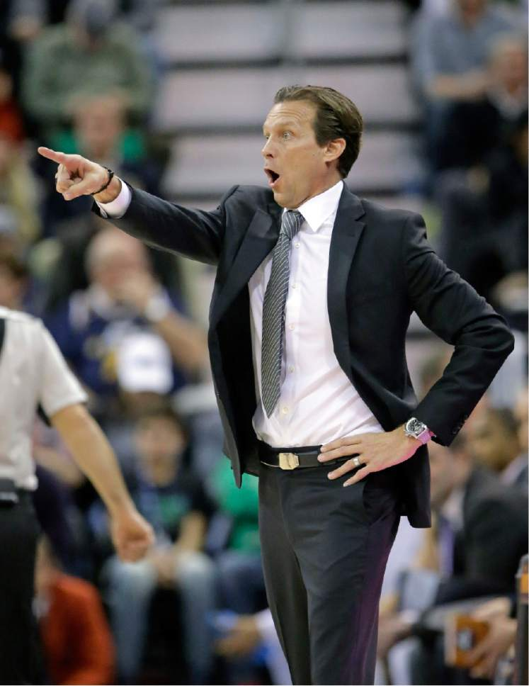 Utah Jazz head coach Quin Snyder shouts to his team in the first half during an NBA basketball game against the Golden State Warriors Thursday, Dec. 8, 2016, in Salt Lake City. (AP Photo/Rick Bowmer)