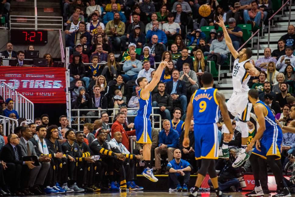 Chris Detrick  |  The Salt Lake Tribune Golden State Warriors guard Klay Thompson (11) shoots past Utah Jazz center Rudy Gobert (27) during the game at Vivint Smart Home Arena Thursday December 8, 2016.