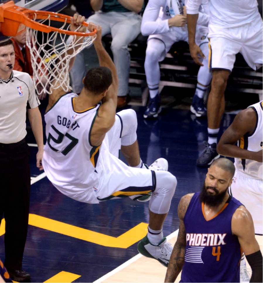 Steve Griffin / The Salt Lake Tribune   Utah Jazz center Rudy Gobert (27) puts the game out of reach with a reverse slam in the closing seconds of the Utah Jazz versus the Phoenix Suns NBA game at Vivint Smart Home Arena in Salt Lake City Tuesday December 6, 2016.
