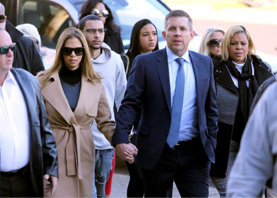 FILE- In this Dec. 10, 2016, file photo, New Orleans Saints head coach Sean Payton walks with Will Smith's widow Racquel into Orleans Criminal Court for the trial of Cardell Hayes in New Orleans. Hayes was convicted of manslaughter Sunday, Dec. 11, in the fatal shooting of retired New Orleans Saints defensive leader Will Smith. The conviction ended a week-long trial in which the defendant insisted he only fired because the popular football star was drunk, violent and had grabbed a gun following a traffic crash on the night of April 9. (Michael DeMocker/NOLA.com The Times-Picayune via AP, File)