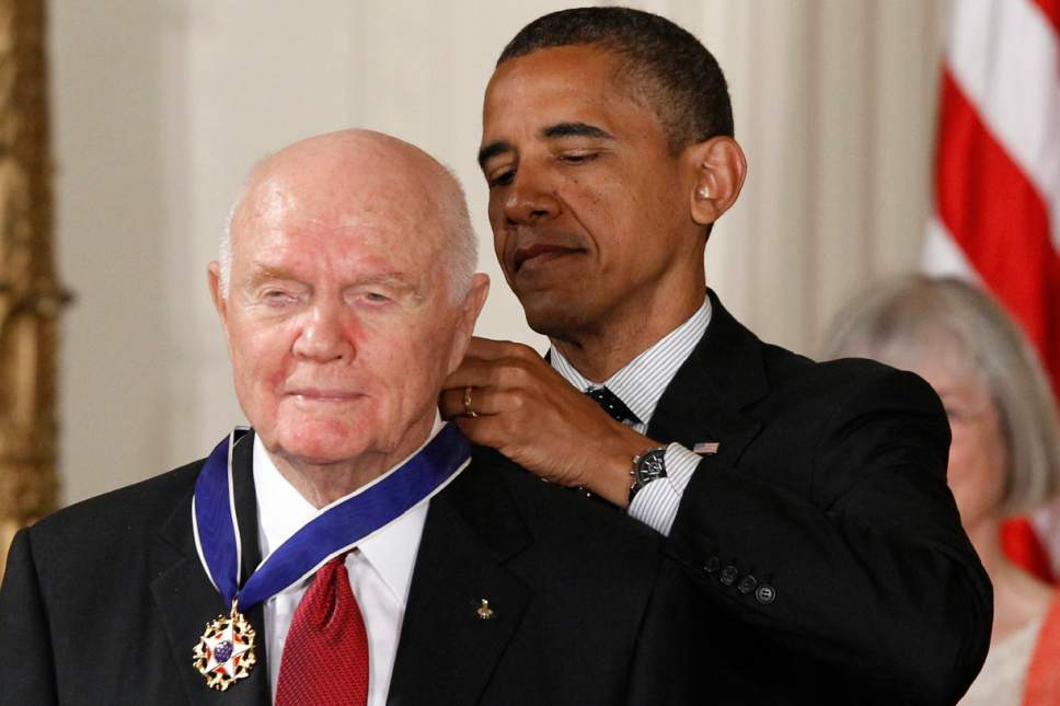 FILE - In this Tuesday, May 29, 2012, file photo, President Barack Obama awards the Medal of Freedom to former astronaut John Glenn during a ceremony in the East Room of the White House in Washington. Glenn, the first American to orbit Earth who later spent 24 years representing Ohio in the Senate, died Thursday, Dec. 8, 2016, at the age of 95. (AP Photo/Charles Dharapak, File)