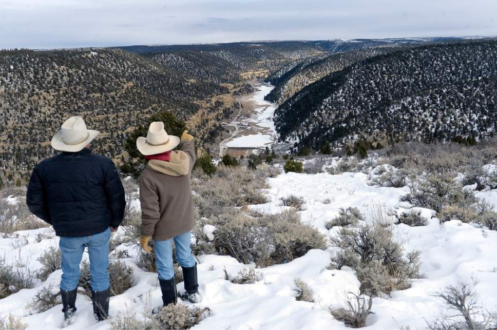 Al Hartmann  |  The Salt Lake Tribune Bert and Christine DeLambert look down onto their cattle ranch along the long valley in Main Canyon in Uintah County Thursday Dec. 8.  DeLambert's land is immediately below the PR Spring tar sands mine on the rim about three miles away.  His springs have gone dry in the years since U.S. Oil Sands drilled exploratory holes and water wells.  The DeLambert's unsucessfully tried to block a water rights transfer to U.S. Oil Sands that would allow them to pump more groundwater.