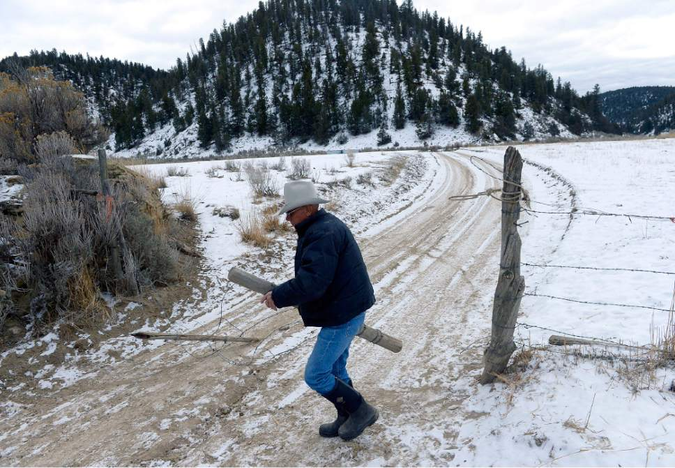 Al Hartmann  |  The Salt Lake Tribune Rancher Bert DeLambert opens a gate to his land in Main Canyon in Uintah County Thursday Dec. 8.  His land is immediately below the PR Spring tar sands mine.  His springs have gone dry in the years since U.S. Oil Sands drilled exploratory holes and water wells.  The DeLambert's unsucessfully tried to block a water rights transfer to U.S. Oil Sands that would allow them to pump more groundwater.