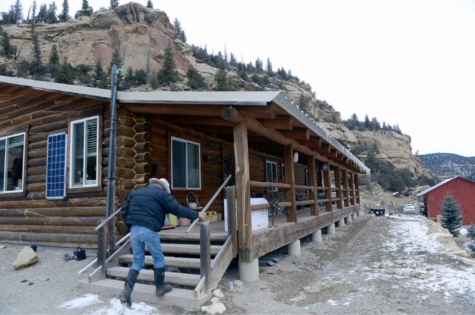 Al Hartmann  |  The Salt Lake Tribune Bert DeLambert heads into his solar powered ranch house on his land in Main Canyon in Uintah County Thursday Dec. 8.  His land is immediately below the PR Spring tar sands mine.  His springs have gone dry in the years since U.S. Oil Sands drilled exploratory holes and water wells.  The DeLambert's unsucessfully tried to block a water rights transfer to U.S. Oil Sands that would allow them to pump more groundwater.