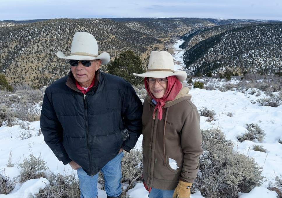 Al Hartmann  |  The Salt Lake Tribune Bert and Christine DeLambert stand above their cattle ranch along the long valley in Main Canyon in Uintah County Thursday Dec. 8.  DeLambert's land is immediately below the PR Spring tar sands mine on the rim about three miles away.  His springs have gone dry in the years since U.S. Oil Sands drilled exploratory holes and water wells.  The DeLambert's unsucessfully tried to block a water rights transfer to U.S. Oil Sands that would allow them to pump more groundwater.