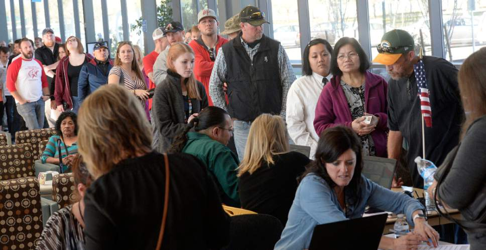 Al Hartmann  |  The Salt Lake Tribune People line up at the polling station at West Jordan Library on election day Tuesday Nov. 8. Polling staff said they were very busy with people qued up at 6:30 a.m. before opening with waits up to two hours mid-morning.