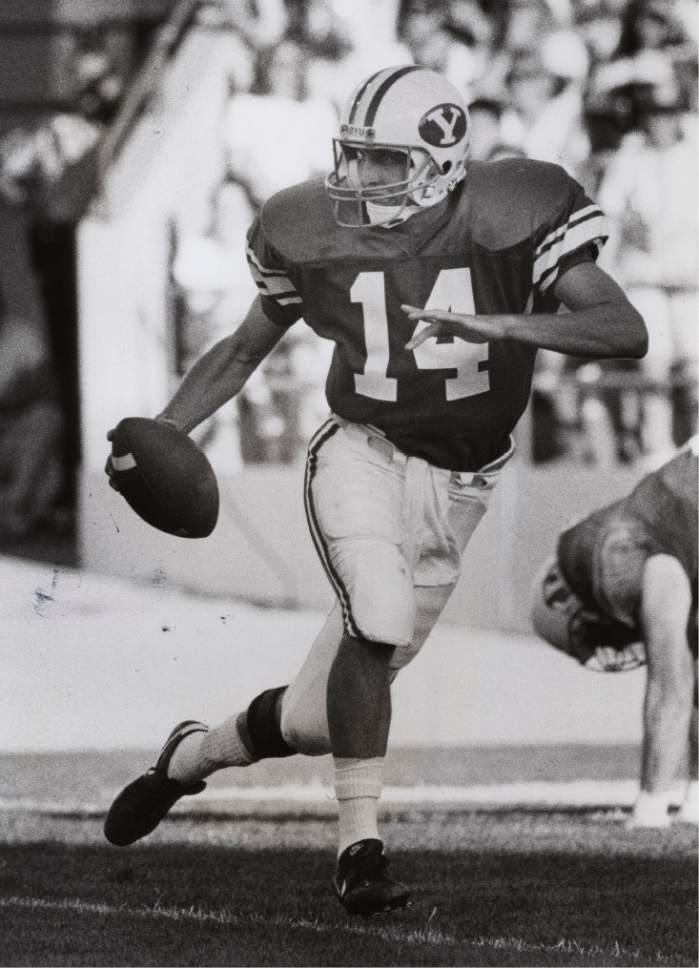 Rick Egan  |  The Salt Lake Tribune   Ty Detmer in action as BYU quarterback on October 25, 1990.