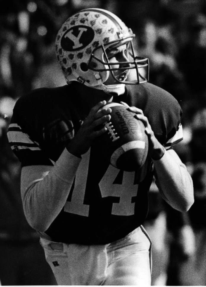 |  Tribune File Photo  Ty Detmer in action as BYU quarterback.