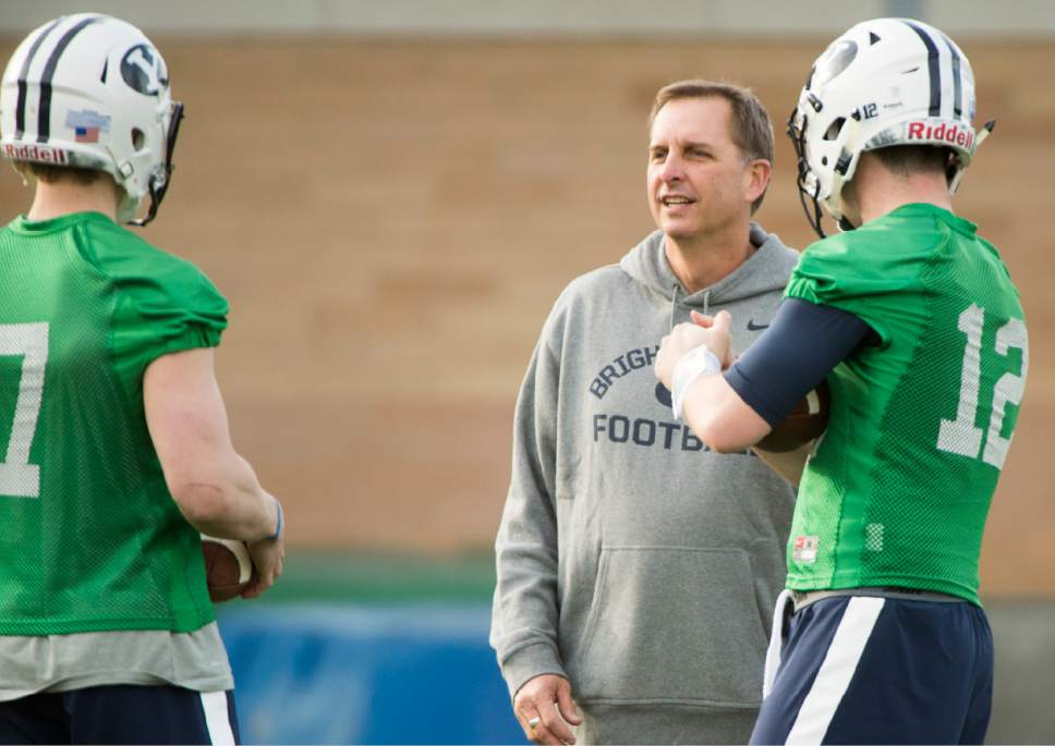 Rick Egan  |  The Salt Lake Tribune  BYU quarterback coach Ty Detmer talks with Beau Hoge (7) and Tanner Mangum (12) on the second day of spring practice, in Provo, Thursday, March 3, 2016.