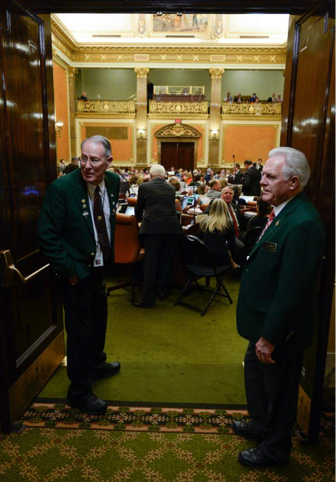 Francisco Kjolseth | The Salt Lake Tribune Green coats Gary Steele, left, and Floyd Ledford man the doors of the House floor during the last night of the Legislature on Thursday, March 10, 2016.