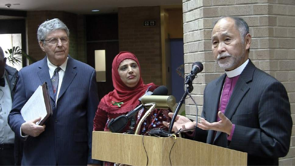 Rabbi Emeritus Fred Wenger (l) of Congregation Kol Ami, Muslim community leader Noor Ul-Hasan and Bishop Scott Hayashi of the Episcopal Diocese of Utah speak during the proclamation of Wednesday, December 14 as Religious Freedom Day in Salt Lake County. / Rich Kane, Salt Lake Tribune