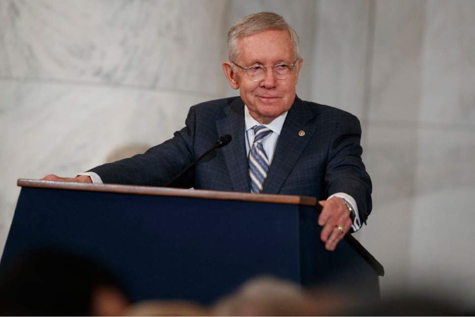 Sen. Harry Reid, D-Nev., speaks during during a ceremony to unveil his portrait, on Capitol Hill, Thursday, Dec. 8, 2016, in Washington. (AP Photo/Evan Vucci)