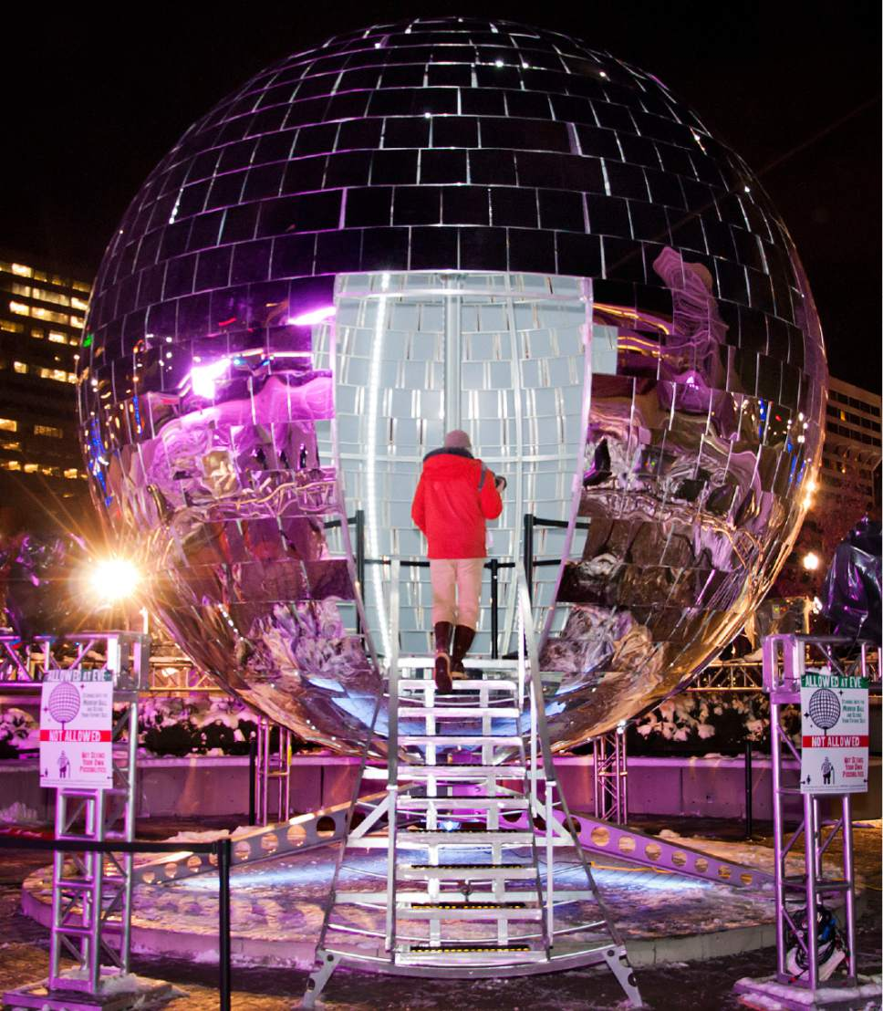 Michael Mangum  |  Special to The Tribune  Spectators roam the inner workings of the giant mirror ball at the first night of EVE at the Salt Palace Convention Center in Salt Lake City on Monday, Dec. 29, 2014.