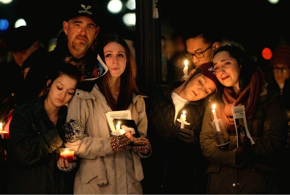 "Steve Griffin / The Salt Lake Tribune   Family members of James Swift mourn their loss as they attend a candle light vigil during the ""Homeless Persons Memorial Day"" gathering for all the homeless people who died in the past year, at Pioneer Park in Salt Lake City Tuesday December 13, 2016."