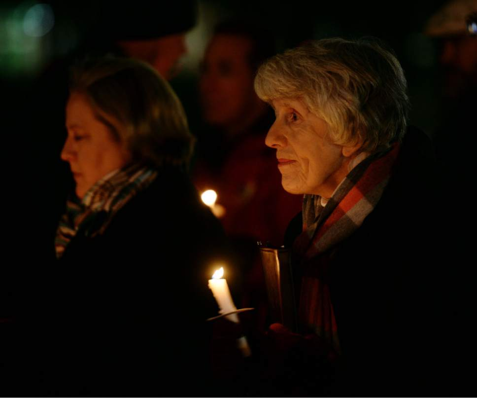 "Steve Griffin / The Salt Lake Tribune   Pamela Atkinson holds a candles as the names of all the homeless people who died in the past year are read during the ""Homeless Persons Memorial Day"" gathering at Pioneer Park in Salt Lake City Tuesday December 13, 2016."