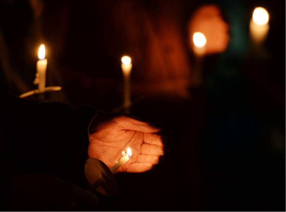 "Steve Griffin / The Salt Lake Tribune   candle light vigil for the homeless dubbed ""Homeless Persons Memorial Day"" for all the homeless people who died in the past year at Liberty Park in Salt Lake City Tuesday December 13, 2016."