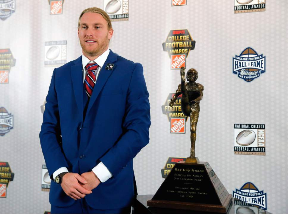 FILE - In this Dec. 8, 2016, file photo, Utah punter Mitch Wishnowsky, of Australia, stands next to the the Ray Guy Award after being named the top punter in college football, in Atlanta. Wishnowsky was selected to the 2016 AP All-America college football team, Monday, Dec. 12, 2016. (AP Photo/John Bazemore, File)