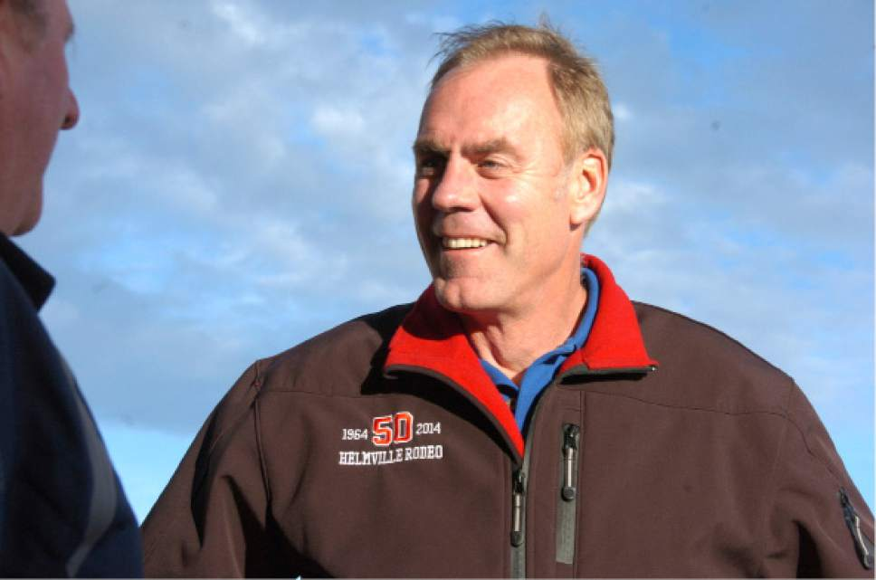 FILE In this Oct. 20, 2016 file photo, Rep. Ryan Zinke, R-Mont. speaks with a supporter in Billings, Mont., as he campaigns for re-election. Edging closer to completing his Cabinet, President-elect Donald Trump announced his choice of Zinke as Interior secretary Thursday, Dec. 15, 2016, picking a man who should fit smoothly into an administration favoring more energy drilling and less regulation. (AP Photo/Matthew Brown, File)