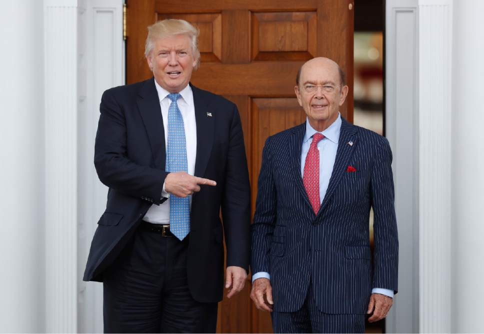 FILE - In this Sunday, Nov. 20, 2016, file photo, President-elect Donald Trump, left, stands with investor Wilbur Ross after meeting at the Trump National Golf Club Bedminster clubhouse in Bedminster, N.J. Trump is poised to offer the position of commerce secretary to the head of a private-equity firm, Wilbur Ross. (AP Photo/Carolyn Kaster)