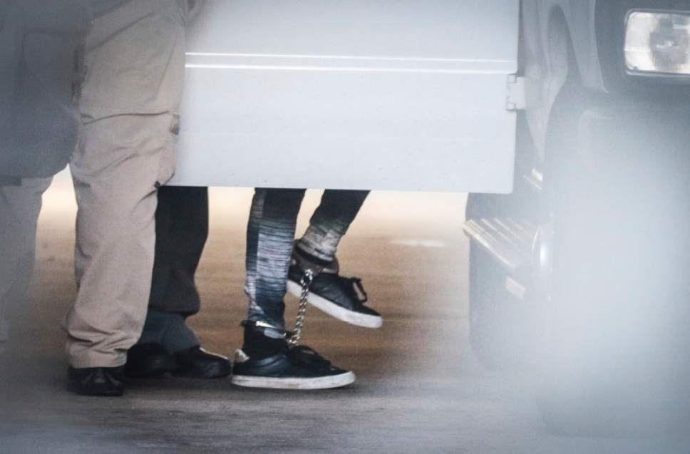 Dylann Roof, wearing shackles, is escorted into a transport vehicle in Charleston, S.C., on Thursday, Dec. 15, 2016 after he was found guilty of murdering nine parishoners at the Emanuel African Methodist Episcopal church. The same federal jury that found Roof guilty of all 33 counts will reconvene next month to hear more testimony and weigh whether to sentence him to death. (Matt Walsh/The State via AP)
