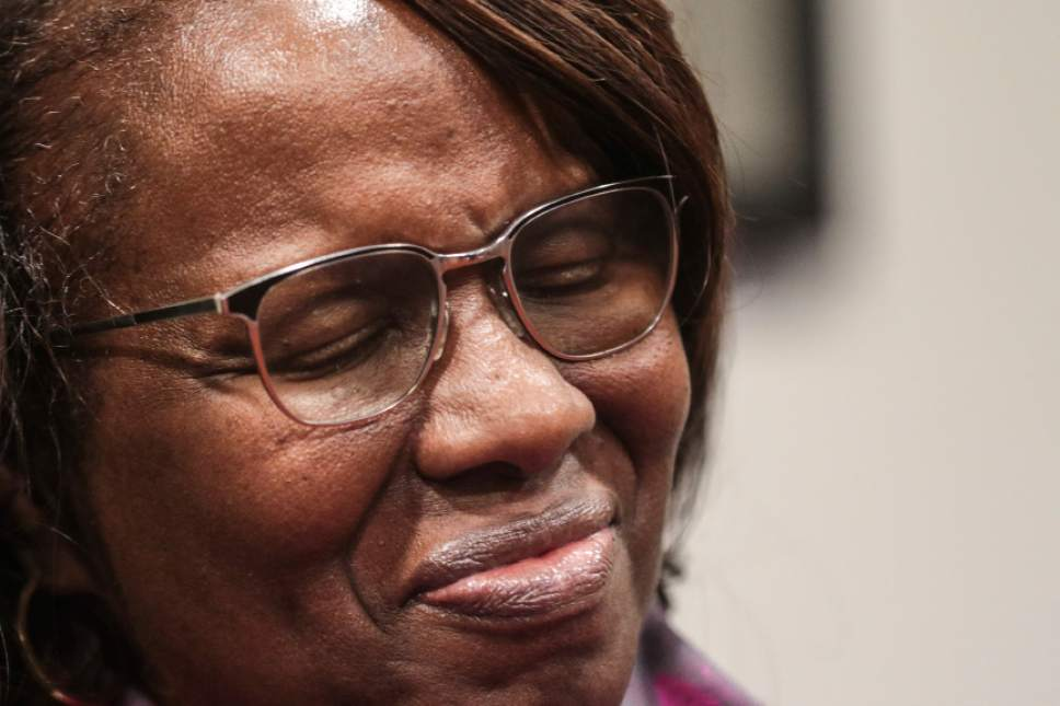 "Felicia Sanders, who watched her son Tywanza Sanders die at the hands of Dylann Roof, smiles while speaking to media after Roof was found guilty of murdering nine parishioners at Emanuel AME Church in Charleston in a hate crime Friday, Dec. 15, 2016, in Charleston S.C. ""I wear a smile now because the nine victims wore beautiful smiles in photos before they were killed,"" Sanders said. (Matt Walsh/The State via AP)"