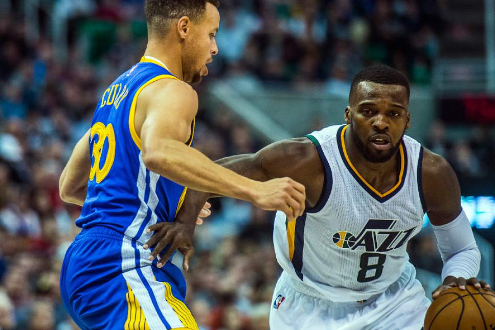 Chris Detrick  |  The Salt Lake Tribune Golden State Warriors guard Stephen Curry (30) guards Utah Jazz guard Shelvin Mack (8) during the game at Vivint Smart Home Arena Thursday December 8, 2016.
