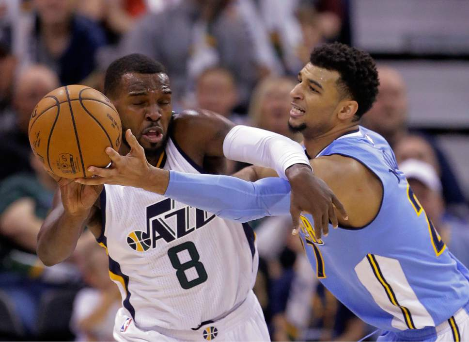Utah Jazz guard Shelvin Mack (8) and Denver Nuggets guard Jamal Murray, right, reach for a loose ball during the second half during an NBA basketball game Saturday, Dec. 3, 2016, in Salt Lake City. The Jazz won 105-98. (AP Photo/Rick Bowmer)