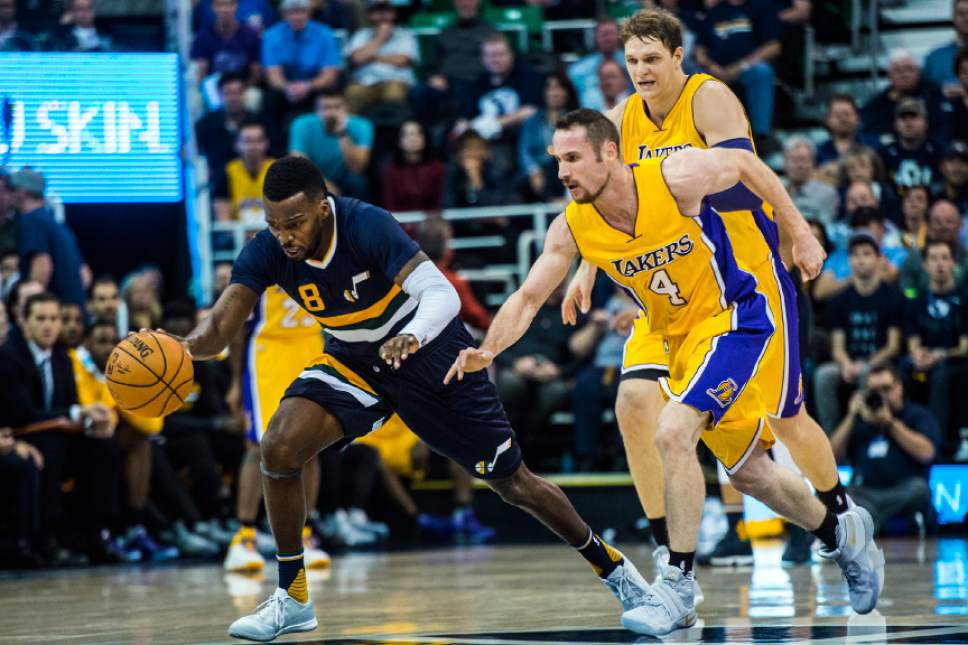 Chris Detrick  |  The Salt Lake Tribune Utah Jazz guard Shelvin Mack (8) and Los Angeles Lakers guard Marcelo Huertas (4) go for the ball during the game at Vivint Smart Home Arena Friday October 28, 2016.