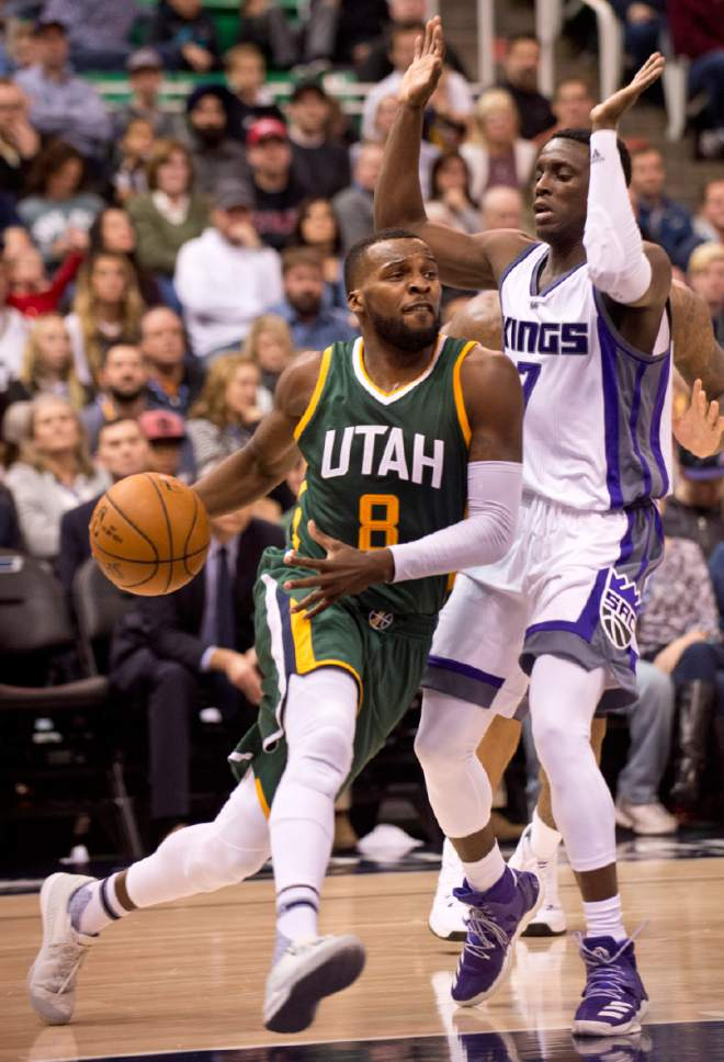 Lennie Mahler  |  The Salt Lake Tribune  Shelvin Mack drives past Darren Collison in the post in the first half of a game Saturday, Dec. 10, 2016, at Vivint Smart Home Arena in Salt Lake City.