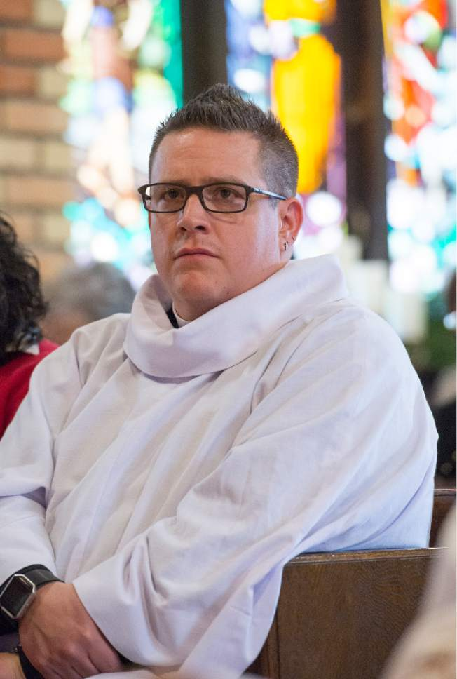 Leah Hogsten  |  The Salt Lake Tribune Rev. Timothy J. Yanni, 34, was ordained as priest in an elaborate ceremony at St. Mary's Episcopal Church in Provo, December 17, 2016.  Yanni was born in Salt Lake City and holds a Master of Divinity degree, a bachelor's degree in business and an MBA. He has done prison ministry and is completing his chaplain-in-training residency at St. Mark's hospital.