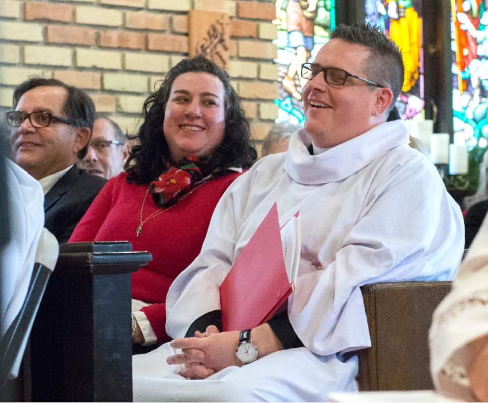 Leah Hogsten  |  The Salt Lake Tribune Rev. Timothy J. Yanni and his girlfriend Brandy (left) laugh as Bishop Scott B. Hayashi of the Episcopal Diocese of Utah delivers his sermon with some comedic asides.  Rev. Timothy J. Yanni, 34, was ordained as priest in an elaborate ceremony at St. Mary's Episcopal Church in Provo, December 17, 2016.  Yanni was born in Salt Lake City and holds a Master of Divinity degree, a bachelor's degree in business and an MBA. He has done prison ministry and is completing his chaplain-in-training residency at St. Mark's hospital.