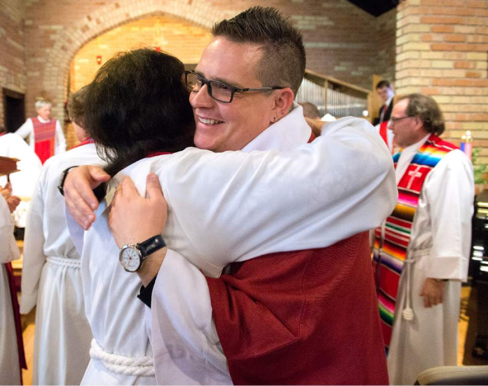 Leah Hogsten  |  The Salt Lake Tribune Father Timothy J. Yanni is welcomed and congratulated by his fellow priests of the Episcopal Diocese of Utah after his ordination ceremony at St. Mary's Episcopal Church in Provo, December 17, 2016. Yanni was born in Salt Lake City and holds a Master of Divinity degree, a bachelor's degree in business and an MBA. He has done prison ministry and is completing his chaplain-in-training residency at St. Mark's hospital.