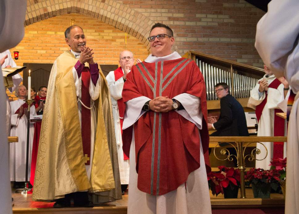Leah Hogsten  |  The Salt Lake Tribune Father Timothy J. Yanni is welcomed and congratulated in applause by  Bishop Scott B. Hayashi and fellow priests of the Episcopal Diocese of Utah after his ordination ceremony at St. Mary's Episcopal Church in Provo, December 17, 2016. Yanni was born in Salt Lake City and holds a Master of Divinity degree, a bachelor's degree in business and an MBA. He has done prison ministry and is completing his chaplain-in-training residency at St. Mark's hospital.