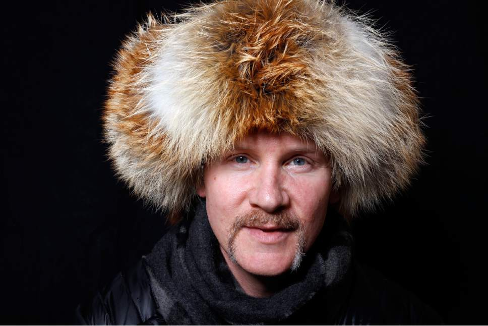 """Filmmakers Morgan Spurlock poses for a portrait to promote the series, """"Eagle Huntress"""", at the Toyota Mirai Music Lodge during the Sundance Film Festival on Saturday, Jan. 23, 2016 in Park City, Utah. (Photo by Matt Sayles/Invision/AP)"""
