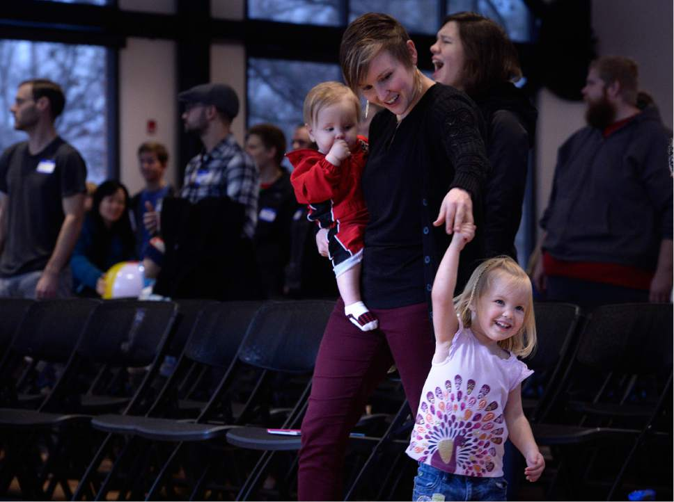 Scott Sommerdorf   |  The Salt Lake Tribune   Jess Williams holds her son Sage as she dances with her daughter Capri during Sunday Assembly Salt Lake City, Sunday, December 9, 2016.