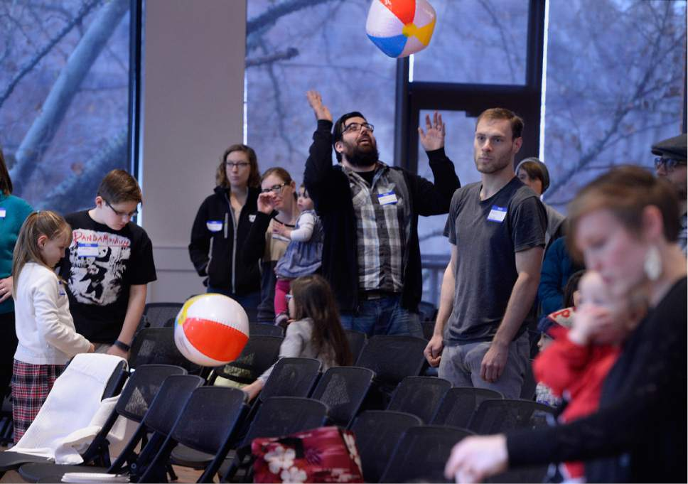 Scott Sommerdorf   |  The Salt Lake Tribune   During the musical numbers at Sunday Assembly Salt Lake City, as those in attendance sang, beach balls were batted about, Sunday, December 9, 2016.