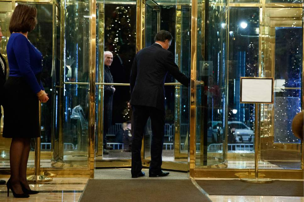 Former Republican presidential nominee Mitt Romney walks off after talking with reporters after eating dinner with President-elect Donald Trump at Jean-Georges restaurant, Tuesday, Nov. 29, 2016, in New York. (AP Photo/Evan Vucci)
