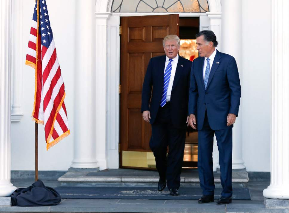 President-elect Donald Trump and Mitt Romney walk from Trump National Golf Club Bedminster in Bedminster, N.J., Saturday, Nov. 19, 2016, as Romney leaves after their meeting. (AP Photo/Carolyn Kaster)