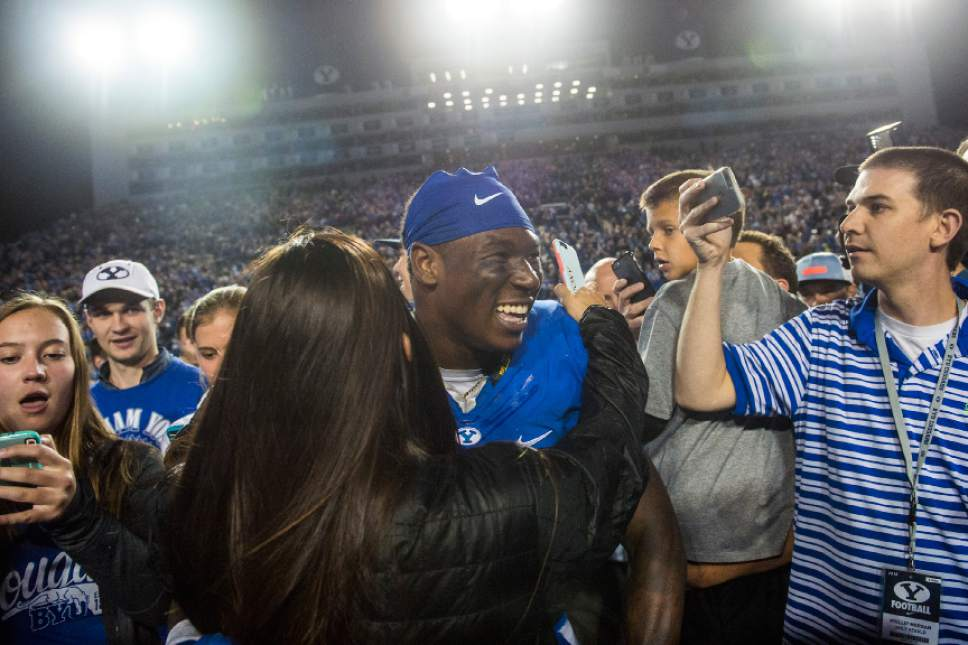 Chris Detrick  |  The Salt Lake Tribune Brigham Young Cougar fans take selfies and hug Brigham Young Cougars running back Jamaal Williams (21) after the game at LaVell Edwards Stadium Saturday October 15, 2016. Brigham Young Cougars defeated Mississippi State Bulldogs 28-21in double overtime.