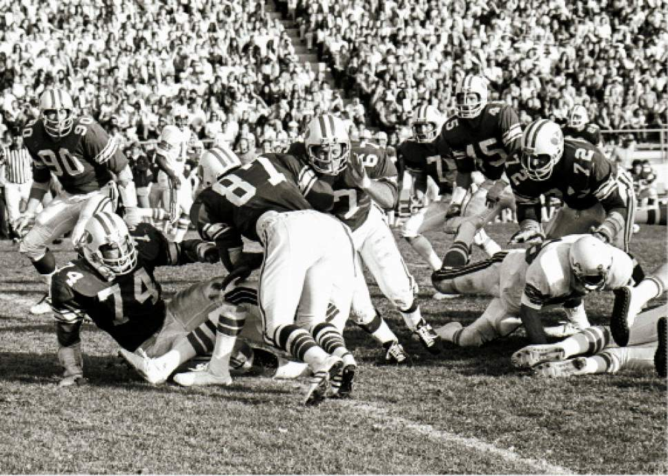 photo by Mark Philbrick/BYU  Larry Carr (67) is seen in action against Arizona in 1973.