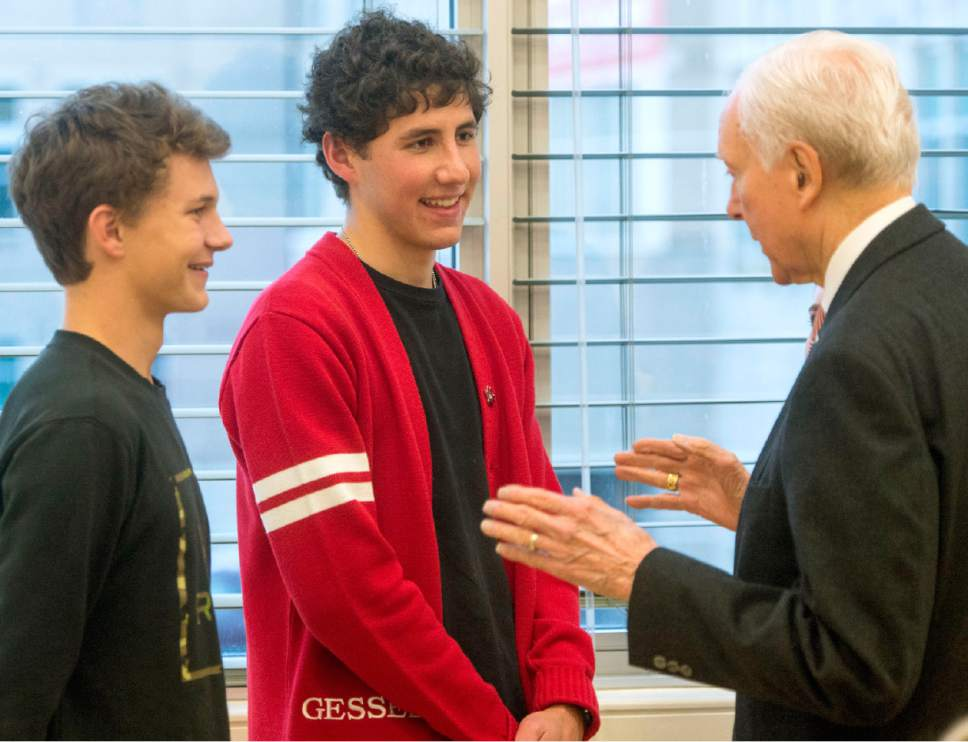 Rick Egan     The Salt Lake Tribune East High students, David Gochnour, and Mathew Gessel visit with Senator Orrin Hatch, after a panel discussion on the prevention and treatment of teen suicide, at East High, Friday, December 16, 2016.
