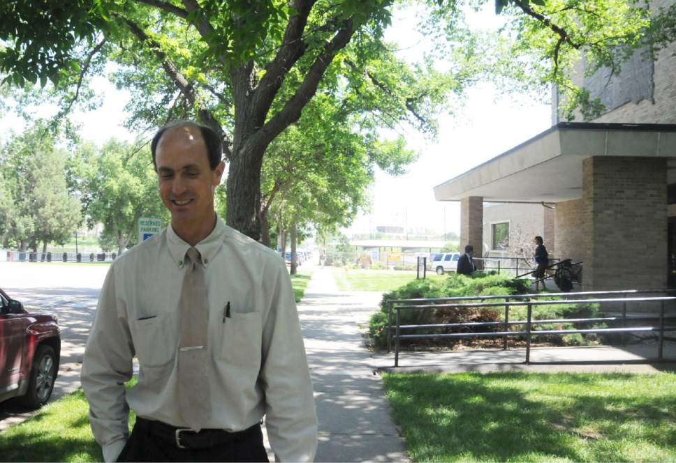 Seth Jeffs, the brother of an imprisoned leader of a polygamist sect, leaves a hearing at a state water board in Pierre, S.D., Thursday, July 9, 2015. Jeffs is attempting to access more water for the sect's remote South Dakota compound, but the board wants more information about what the group needs the water for. (AP Photo/James Nord)