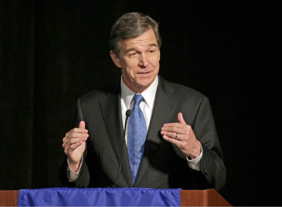 FILE - In this June 24, 2016, file photo, North Carolina Attorney General Roy Cooper speaks during a forum in Charlotte, N.C. North Carolina legislators will repeal the contentious HB2 law that limited protections for LGBT people and led to an economic backlash, the state's incoming governor, Roy, said Monday, Dec. 19. (AP Photo/Chuck Burton, File)