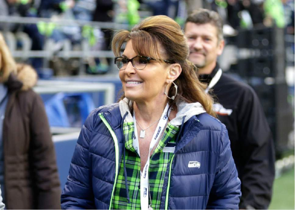 FILE - In a Thursday, Dec. 15, 2016 file photo, Sarah Palin, political commentator and former governor of Alaska, walks on the sideline before an NFL football game between the Seattle Seahawks and the Los Angeles Rams, in Seattle. A story claiming Palin called for boycotting the Mall of America in Minnesota over its black Santa Claus is false.  (AP Photo/Scott Eklund, File)